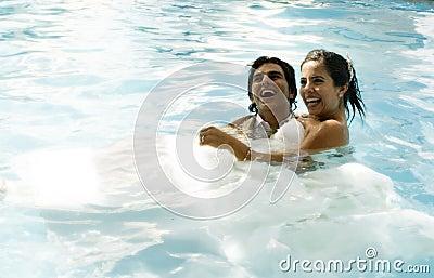 Wedding couple swimming