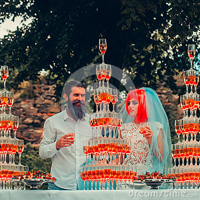 Free Wedding Couple With Pyramids Of Wine Glasses Outdoor Royalty Free Stock Images - 74593549