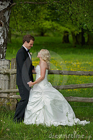 Wedding couple at wooden gate