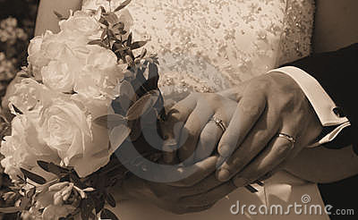Wedding Day hands, rings and bouquet