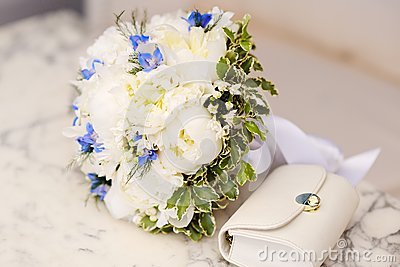 Wedding bouquet of white peonies