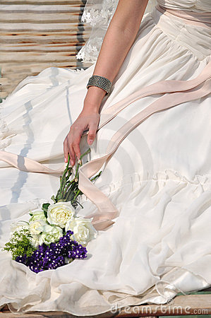 Wedding dress bride and bouquet