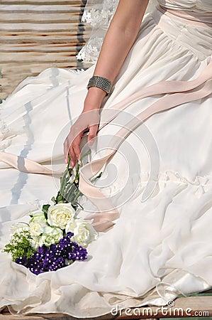 Wedding dress bride and bouquet