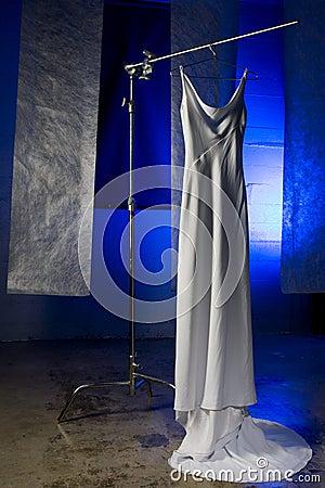 Wedding dress on hanger against blue