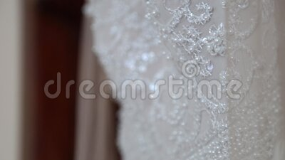 Wedding dresses in bridal salon. Details of bridal dress. Wedding dresses in bridal salon. White wedding dress stock video