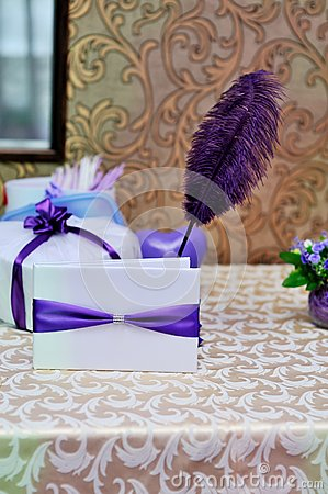 Free Wedding Envelope With A Purple Ribbon And Pen Royalty Free Stock Photography - 34011797
