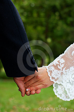 Wedding feelings. Couple holding hands.