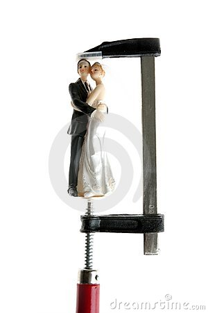 Wedding figurine under pressure