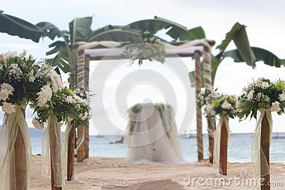 Wedding flower arch, post and decoration on beach