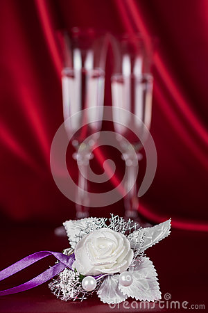 Wedding flower on the background of two wine glasses