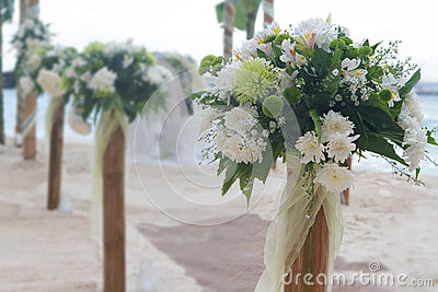 Wedding flower post on beach