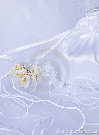 Wedding flowers and bridal bag over veil