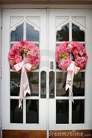 Free Wedding Flowers On The Front Door Of A Church Stock Photo - 4778380