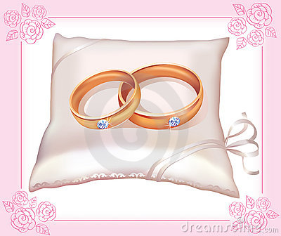 Wedding gold rings on satin pillow
