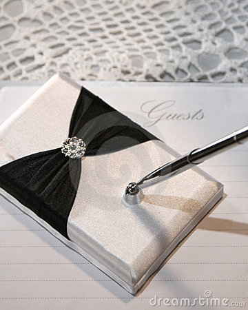 Wedding or guest book and pen