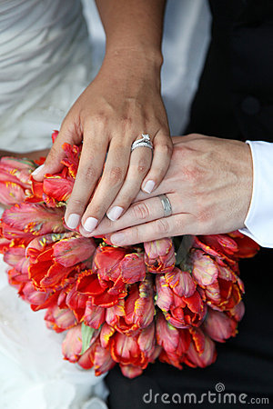 Wedding Hands and Rings on Bouquet
