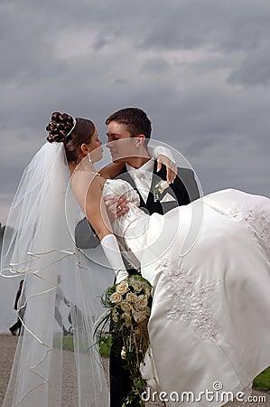Wedding hot couple having fan
