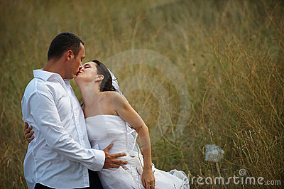 Wedding kiss (bride and groom love)
