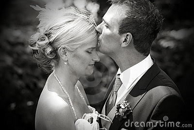 Wedding kiss on forehead