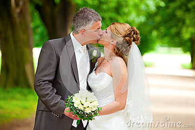 Wedding kiss on path sexy couple