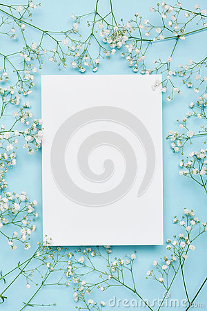 Free Wedding Mockup With White Paper List And Flowers Gypsophila On Blue Background From Above. Beautiful Floral Pattern. Flat Lay. Royalty Free Stock Image - 79676386