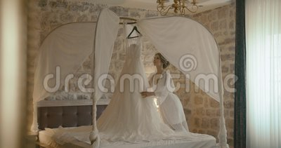 Wedding At Montenegro. Traditional European Ceremony. Morning Before The  Reception. 4k. Bride In Delicate Silk Robe Stock Footage - Video of happy 220ef8cbb
