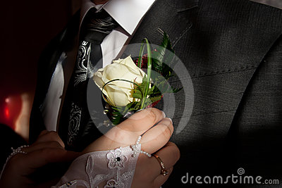 Wedding posy on the lapel of groom s jacket