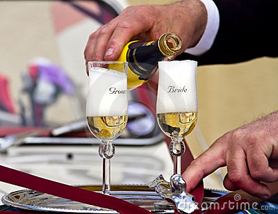 Wedding Pouring Champagne to Groom & Bride Glasses