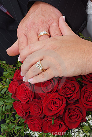 Wedding red rose bouquet and rings