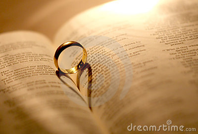 a wedding ring in the bible royalty free stock image