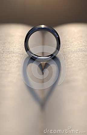 Free Wedding Ring Casting A Heart Shadow Between Pages Of A Book Royalty Free Stock Image - 34086106