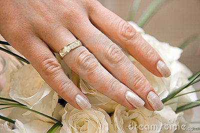 Wedding ring on a female hand