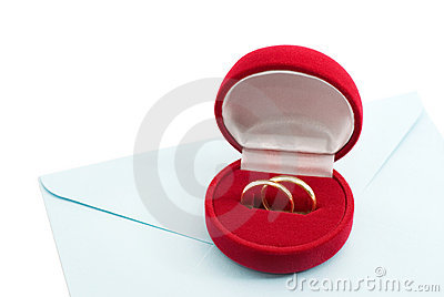 Wedding ring in a gift box on the mail envelope