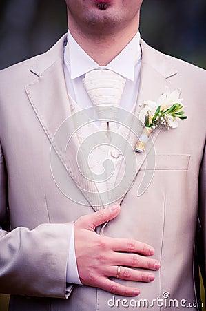 Wedding ring on grooms hand