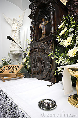 Wedding rings on altar