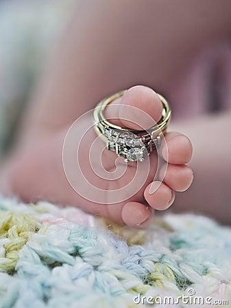 Wedding rings on baby foot
