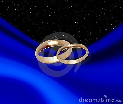 Wedding rings on blue drapery