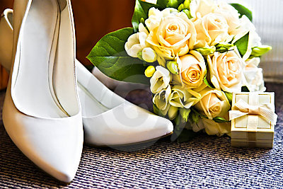 Wedding rings with bouquet and high heel shoes
