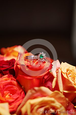 Wedding Rings on Bouquet - Roses
