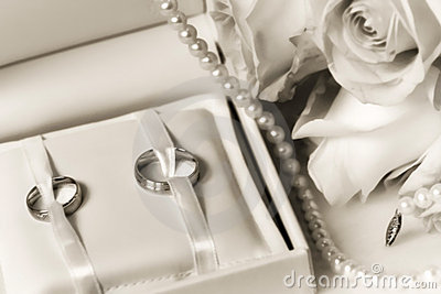 Wedding rings in a box with bouquet