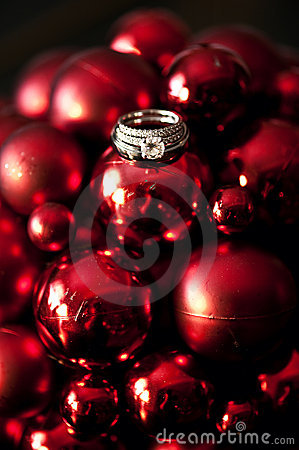 Wedding rings on Christmas ornaments
