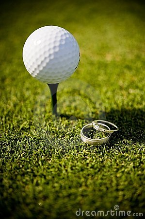Wedding rings with golf ball on tee