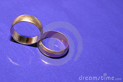 Wedding rings over blue
