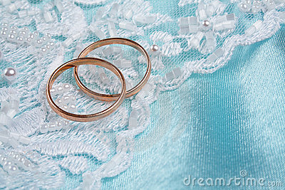 Wedding rings over blue backgound