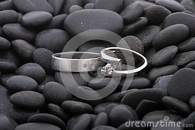 Wedding rings on pebbles