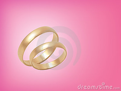Wedding rings on pink background