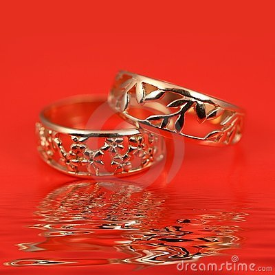 Wedding rings on red background