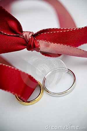 Wedding rings and a red ribbon