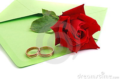 Wedding rings and red rose