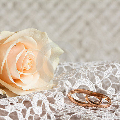 Wedding rings and rose.